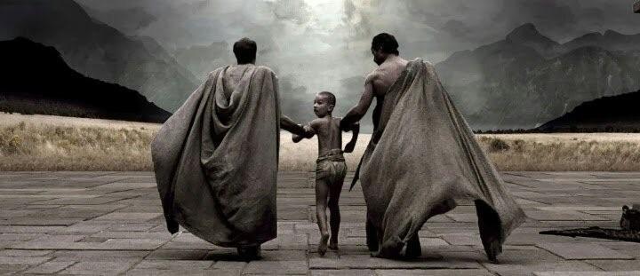 A imagem representa o ato de jogar as crianças no abismo, mostrando dois homens de capa segurando uma criança pelos braços entre eles. A imagem é escura e sombria.
